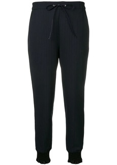 3.1 Phillip Lim tapered pinstriped trousers