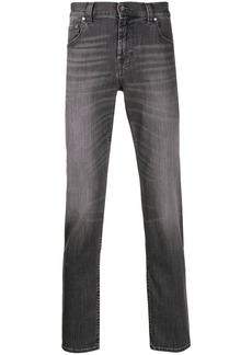 7 For All Mankind tapered stonewashed jeans