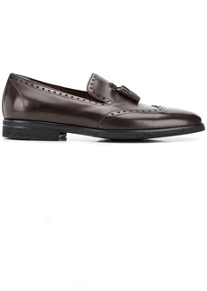A. Testoni brogue detail loafers
