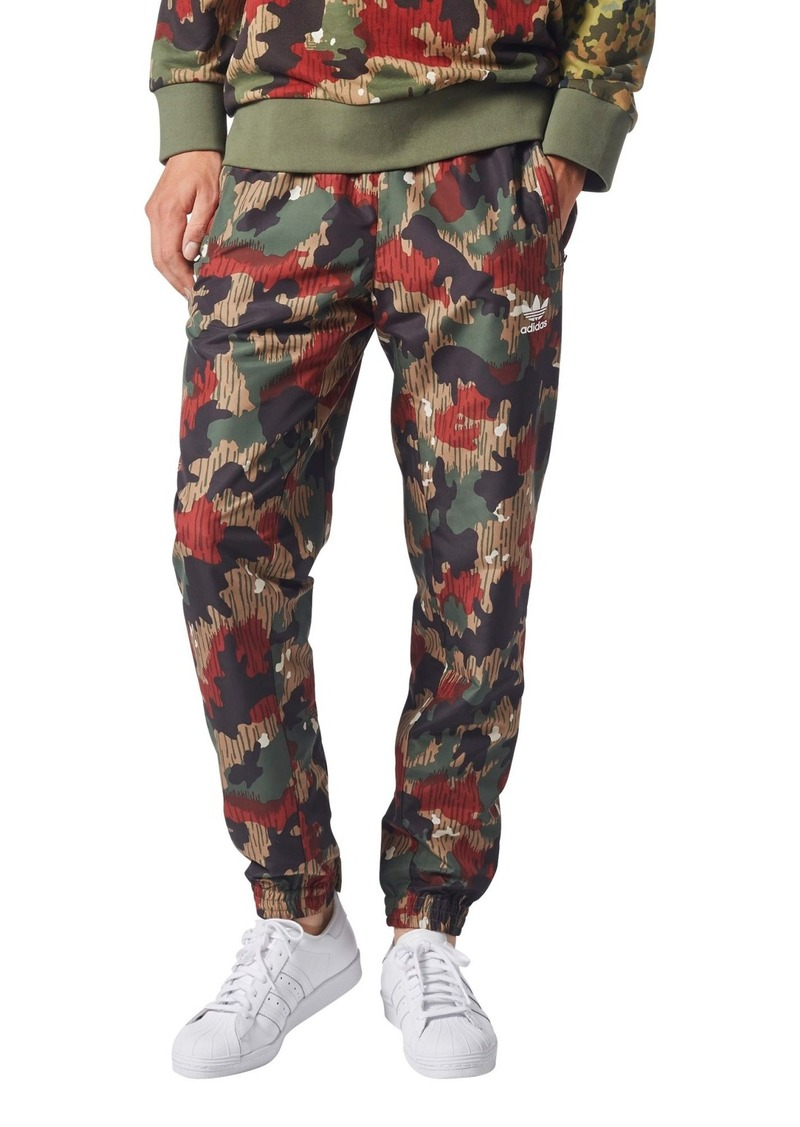 the best attitude e6a7a 8a588 adidas Originals Pharrell Williams Hu Hiking Wind Pants