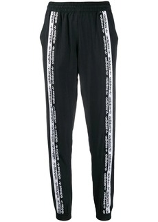 Adidas logo lined track pants