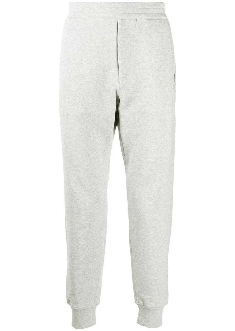 Alexander McQueen skull patch track trousers
