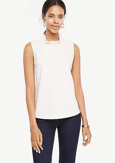 Pearlized Button Ruffle Neck Shell