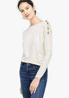 Pearlized Button Shoulder Slit Sweater