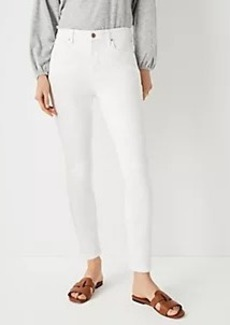Ann Taylor Sculpting Pocket Mid Rise Skinny Jeans in White