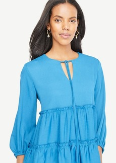 Tiered Ruffle Tie Neck Top
