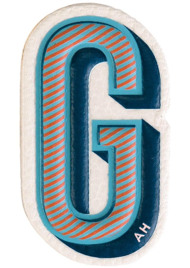 Anya Hindmarch 'G' sticker