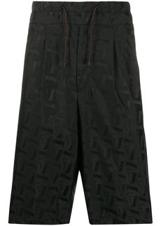Armani all-over logo print shorts