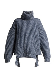 Balenciaga Oversized cut-out hem wool sweater