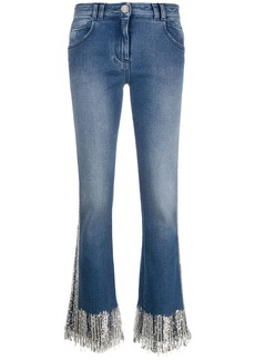 Balmain fringed low-rise flared jeans