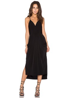 BCBGeneration Crossover Midi Dress in Black. - size M (also in S,XS)