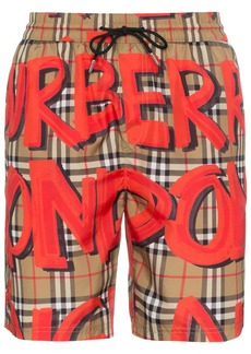 Burberry graffiti logo check print swim shorts