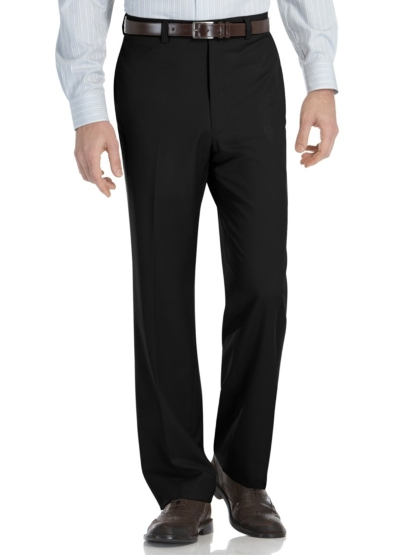 Our comfortable flat-front dress pants with a self-adjusting waist have two hidden side panels that expand your waistband up to 4