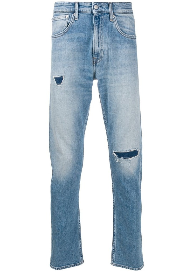 Calvin Klein distressed slim-fit jeans