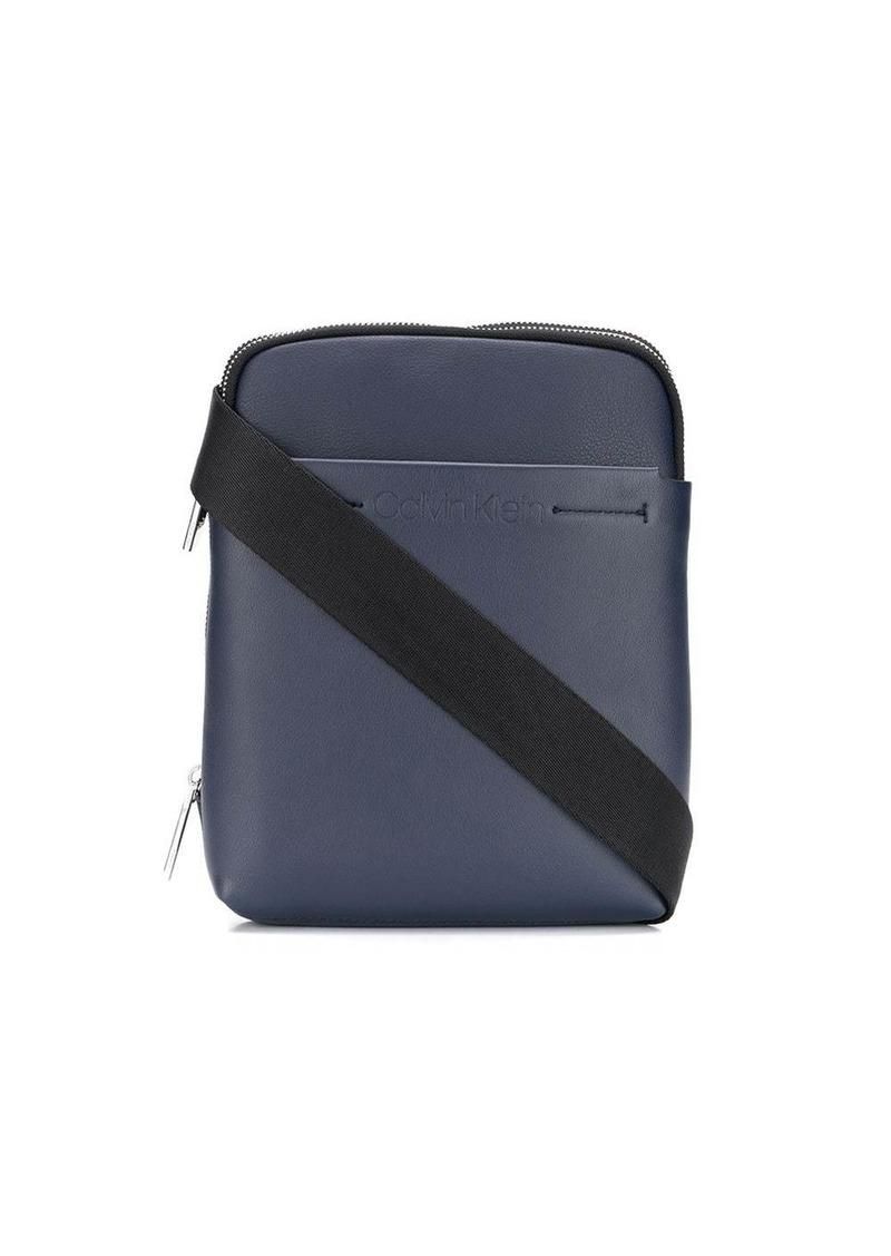 Calvin Klein embossed logo messenger bag