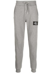 Calvin Klein logo-patch tapered track pants