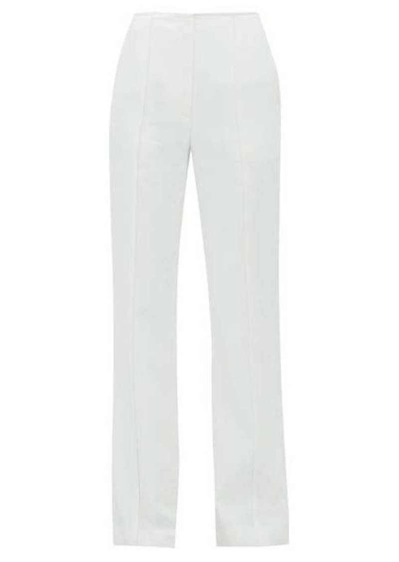 Carolina Herrera Stitched-seam flared-leg twill trousers
