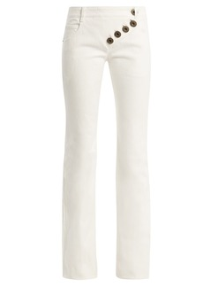 Chloé Mid-rise asymmetric-button flared jeans