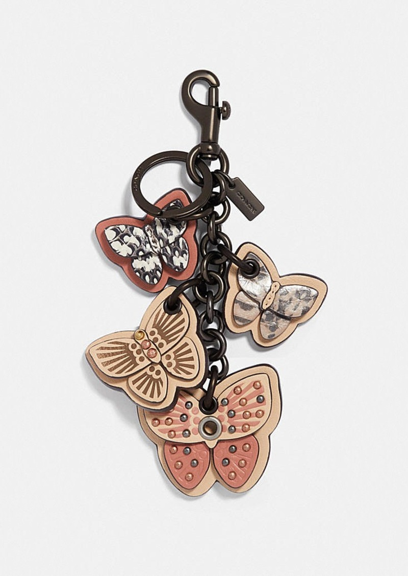 Coach butterfly cluster bag charm with snakeskin detail
