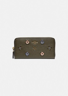 Coach accordion zip wallet with scattered rivets
