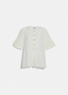 Coach broderie anglaise top