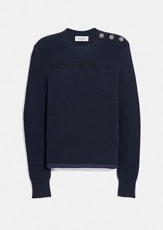 reverse coach sweater