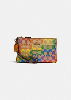 Coach small wristlet in rainbow signature canvas