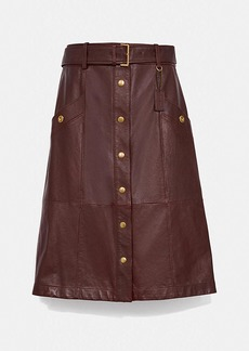 Coach snap front leather skirt