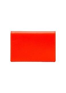 Comme des Garçons fluorescent orange leather wallet