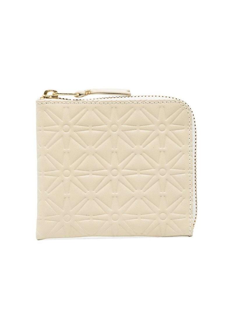 Comme des Garçons star pattern zip-around embossed wallet