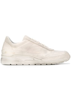 Common Projects dirty white sneakers