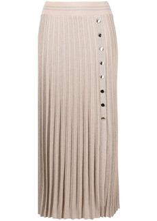 D.Exterior pleated press-stud skirt