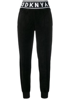 DKNY logo print track trousers