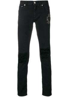 Dolce & Gabbana crest embroidered skinny jeans - Black