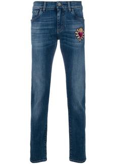 Dolce & Gabbana Sacred Heart patch jeans - Blue