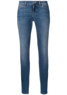 Dolce & Gabbana skinny jeans with floral button