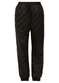 Fendi FF-logo technical-shell track pants