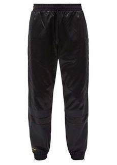 Fendi Logo-embroidered paneled-shell track pants