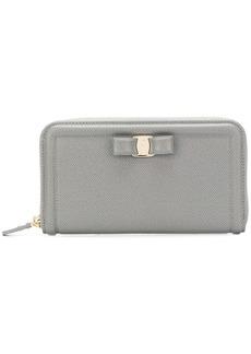 Ferragamo zip around bow wallet