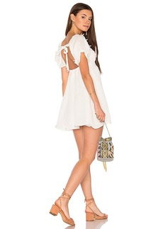 For Love & Lemons Crema Babydoll Dress in White. - size L (also in M,S,XS)