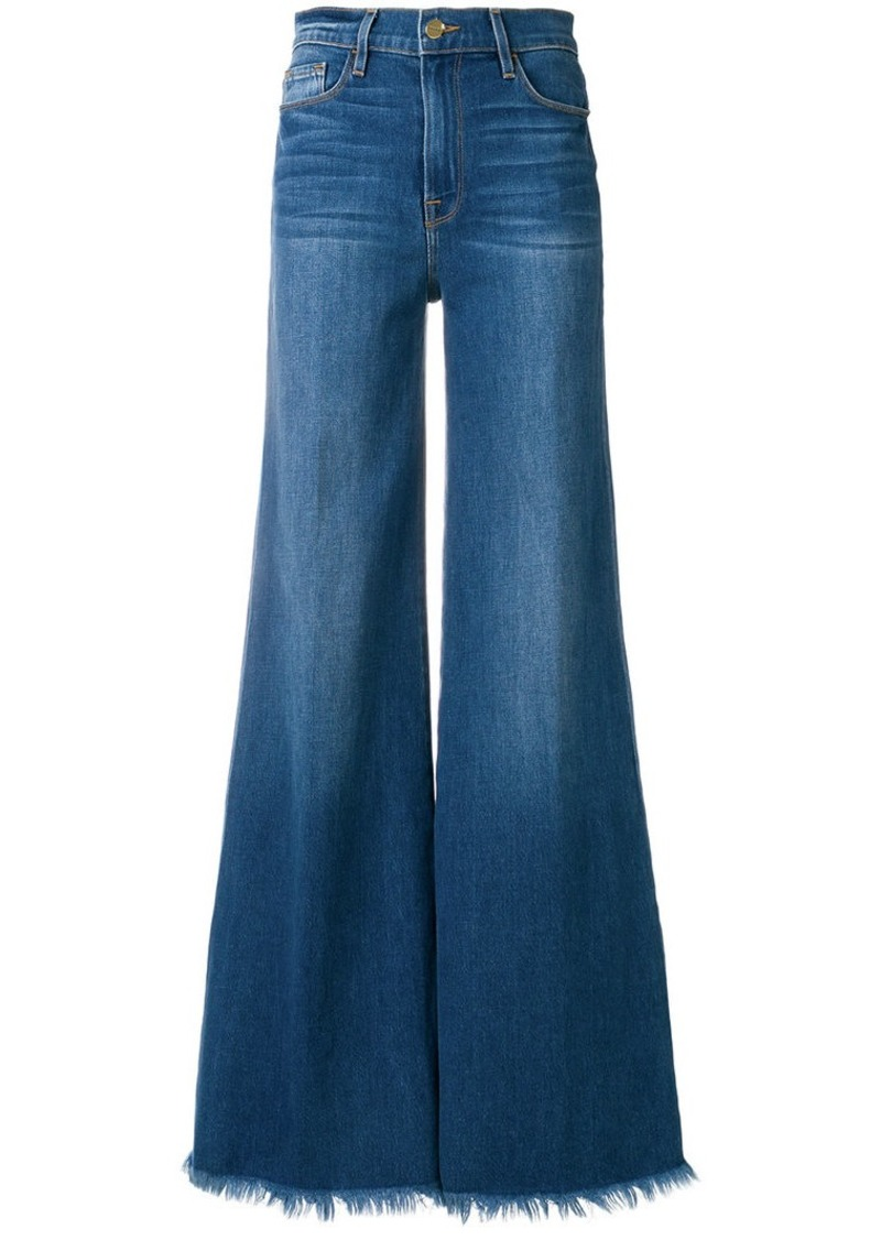 FRAME frayed-hem flared jeans