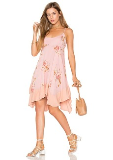 Free People Faded Bloom Mini Dress in Pink. - size L (also in M,S,XS)