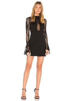 Free People It's Now or Never Mini Dress in Black. - size L (also in S,XS)