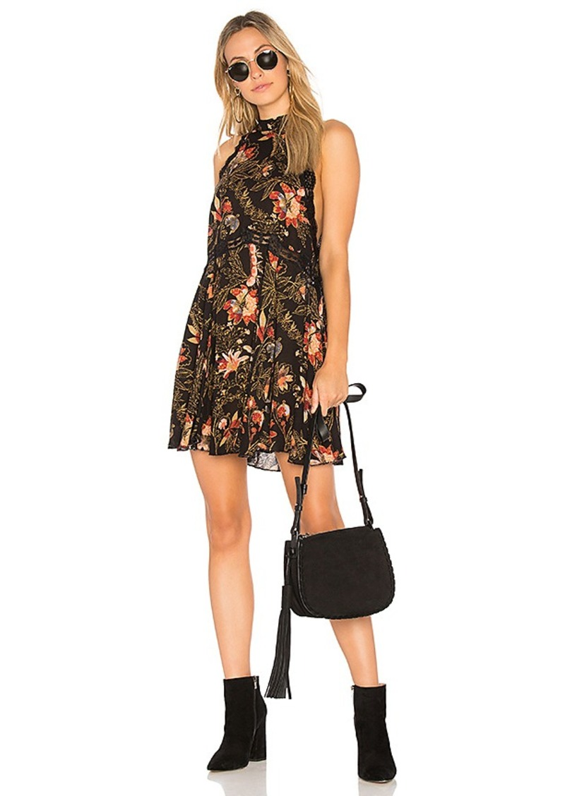 Free People Printed She Moves Mini Dress in Black. - size L (also in M,S,XS)