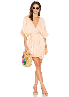 Free People Ripple Mini Dress in Peach. - size 0 (also in 2,4,6)