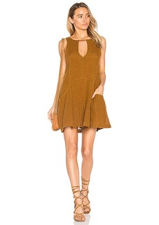 Free People Smooth Sailing Mini Dress in Yellow. - size L (also in M,S,XS)