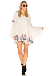 Free People Te Amo Mini Dress in White. - size L (also in M,S,XS)
