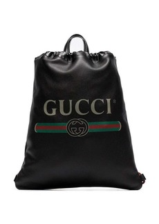 Gucci black logo print leather drawstring backpack