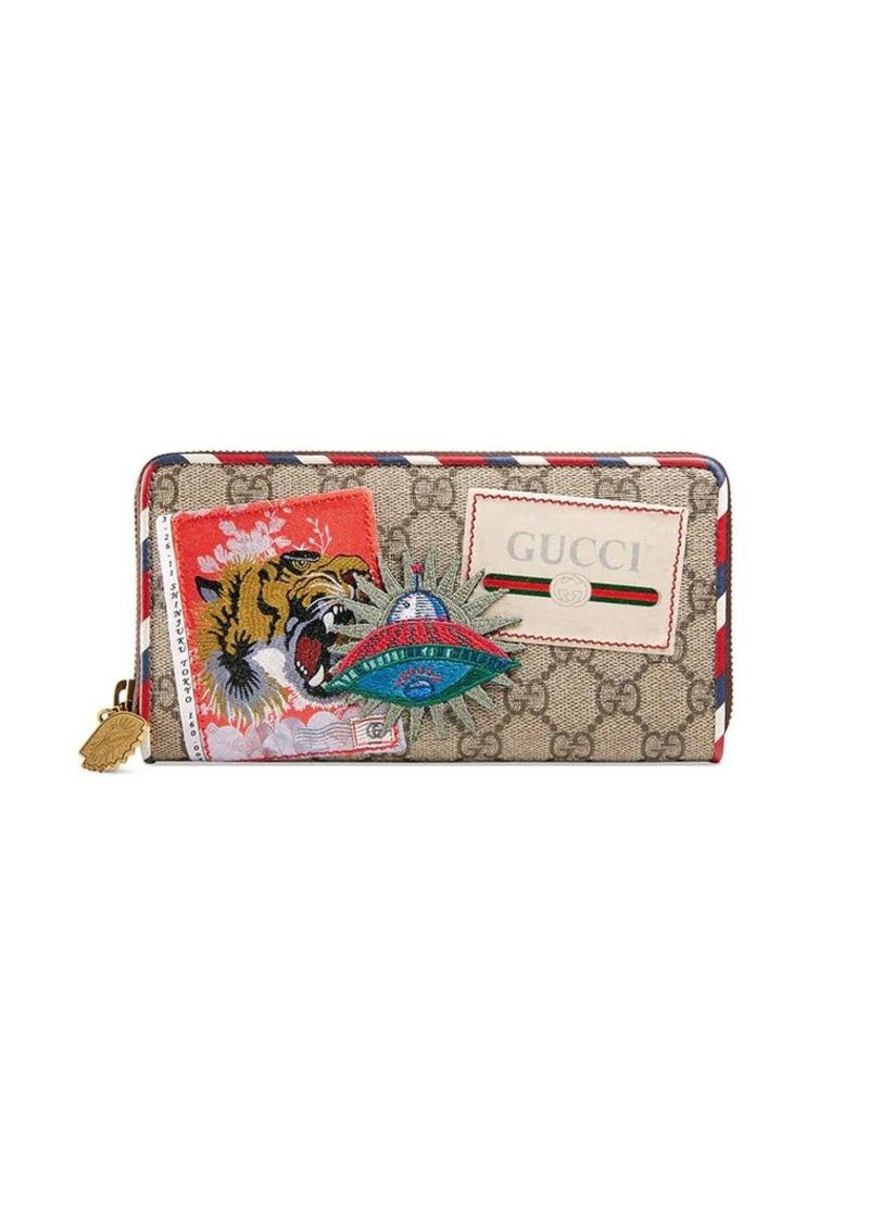621a36b6448 Gucci Gucci Courrier GG Supreme zip around wallet