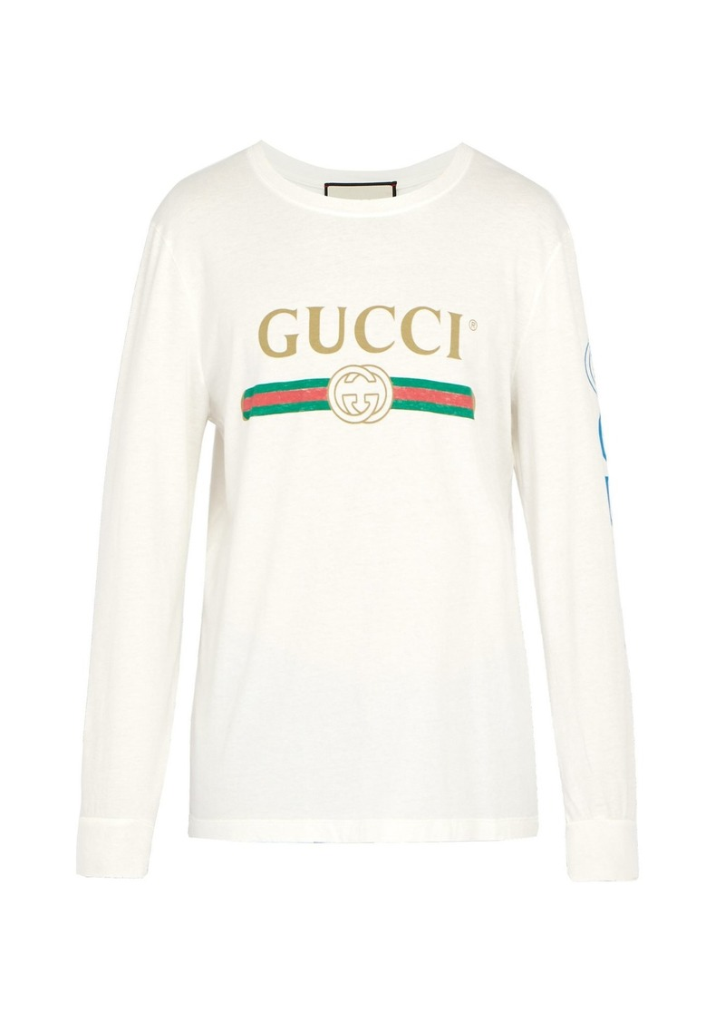 c58314e8a879 Gucci Gucci Fake logo-print dragon-embroidered T-shirt | T Shirts